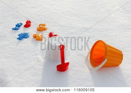 Overhead View On Colorful Bucket And Shovel, Covered Snow