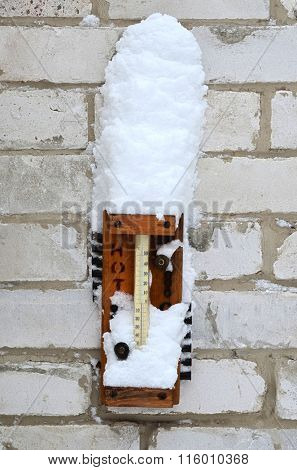 Kiev, Ukraine - January 16: Outdoor thermometer after heavy snowfall on January 16, 2016 in Kiev, Ukraine