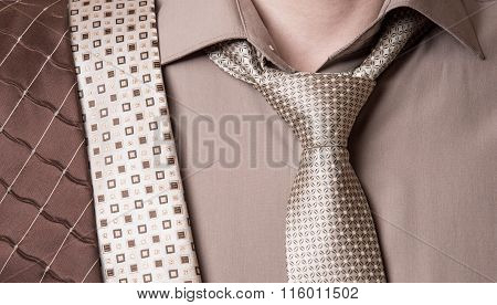 Businessman Selects A Tie Close Up On White Background
