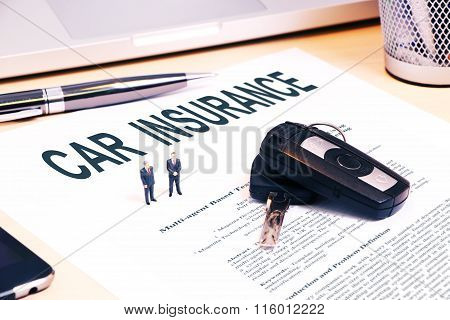 Tiny Businessdolls on contract with car key