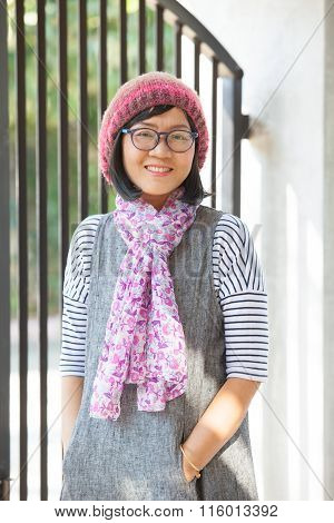 Portrait Of Beautiful 40S Years Asian Woman Wearing Wool Hood And Silk Scarf Toothy Smiling With Hap