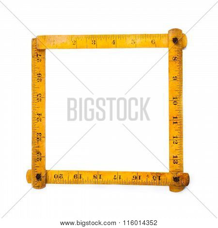 Retro wooden carpenter ruler measure. measuring tools. square shape. on white background. copy space