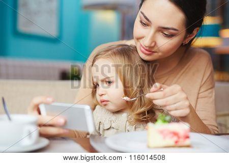 Feeding daughter