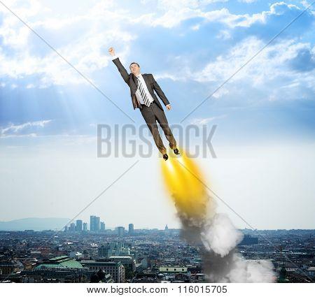 Businessman like superman flying