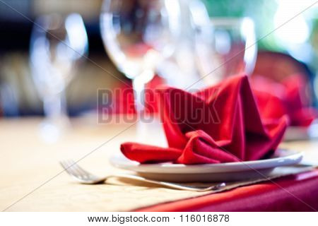 Abstract blurred served table. Romantic restaurant interior. colorful still life and service concept