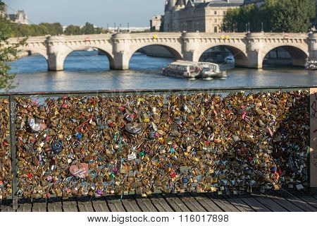 PARIS FRANCE - SEPTEMBER 9 2014: Paris France - Pont des Arts. Love padlocks on the bridge. Passerelle des Arts is a pedestrian bridge in Paris which crosses the River Seine