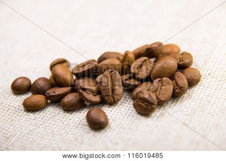 Many Of Roasted Coffee On A Tablecloth