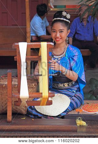 woman is weaving outdoor, Bangkok, Thailand