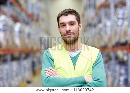 happy man in reflective safety vest at warehouse