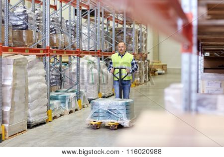 man carrying loader with goods at warehouse
