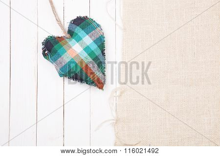 Handmade Heart Of Scrim Hanging On A Wooden  Wall