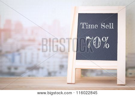 Concept Time Sell 70% message on wood boards