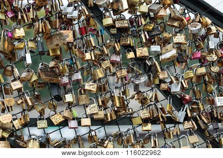 PARIS FRANCE - SEPTEMBER 11, 2014: Paris France - Pont des Arts. Love padlocks on the bridge. Passerelle des Arts is a pedestrian bridge in Paris which crosses the River Seine