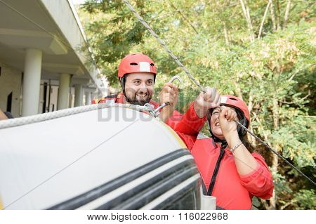 Couple Preparing For Rafting