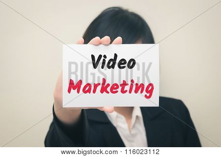 video marketing message on the card Held by women.