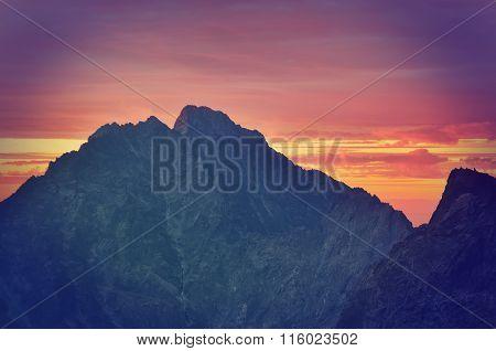 Mountain landscape at sunset.