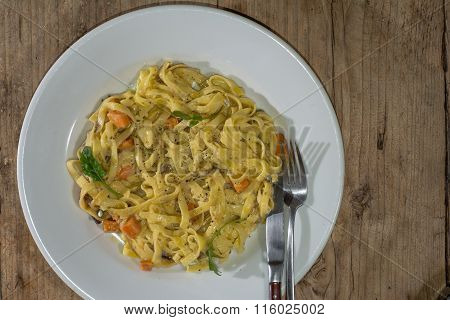 Sweet potato, goat's cheese and red onion tagliatelle plate with cutlery
