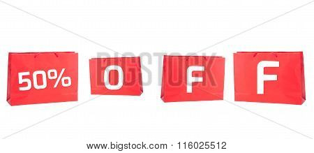Fifty or 50 percent off discount concept using 50% written on red shopping bags isolated on white background