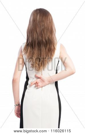 Woman Holding Fingers Crossed Behind Her Back.