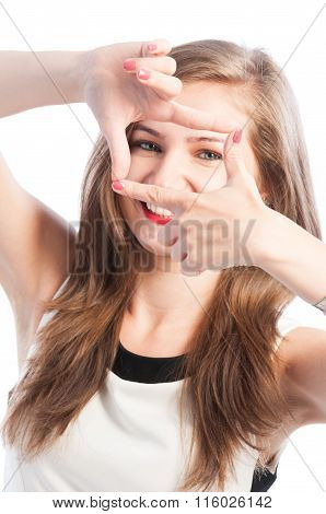 Woman Framing Her Eyes With Fingers.