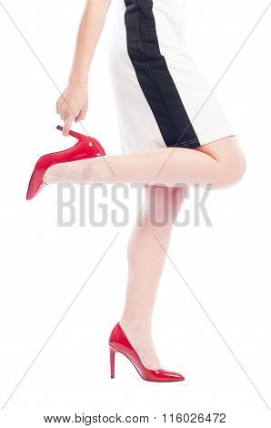 Woman With Red Shoes Grabbing One Leg Heel.