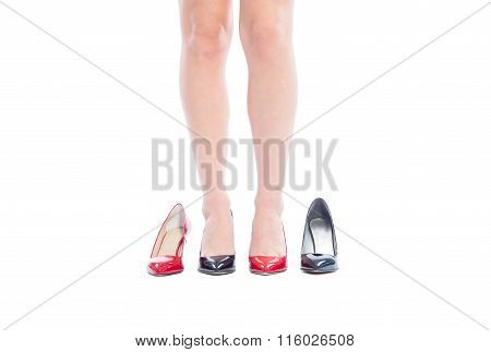 Woman Legs Wearing Different Color Shoes.