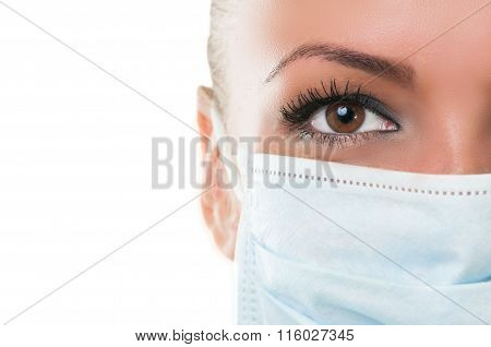 Close-up Of Eye And Mask Of Doctor Assistant.
