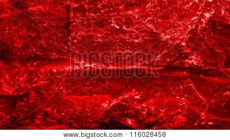 Red flag painted on stones. Red stone