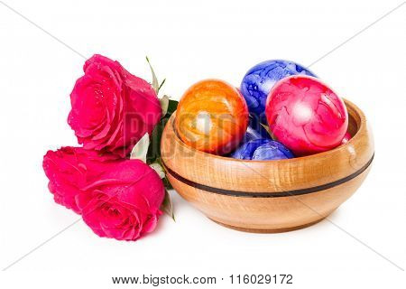 Easter eggs with a bouquet of roses isolate on a white background