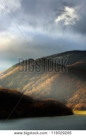 light and shadow. games of lights and shadows in autumn mountain landscape. Low key, dark background