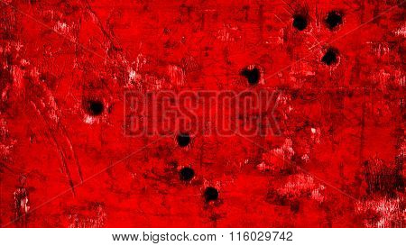 Red flag painted on metal with bullet holes