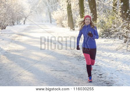 Pretty Woman Jogging In Winter With Earphones