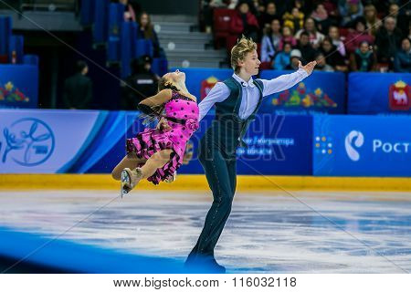 young pair skaters on ice sports arena