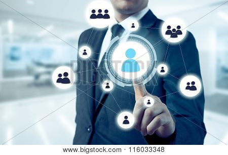 businessman points to icon-HR, recruitment and chosen concept
