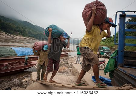 Laotian Porters On The Mekong River