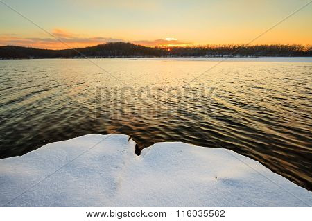 Snowy Sunset At The Lake