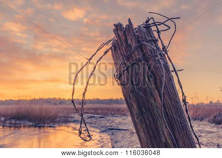 Wooden Fence Post With Barb Wire
