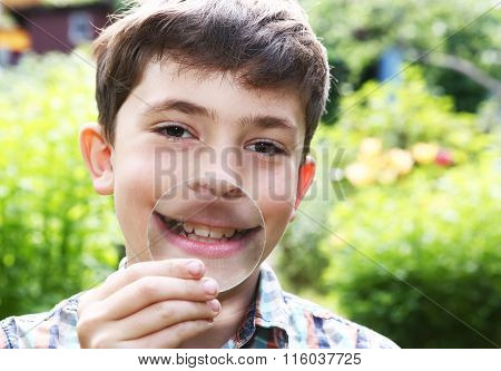 Boy Magnify His Lips With Magnifying Glass