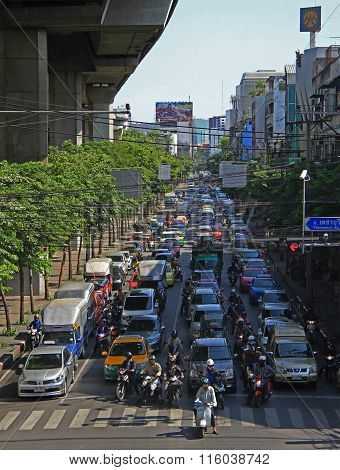 people in cars, buses and on motorbikes are moving, Bangkok, Thailand
