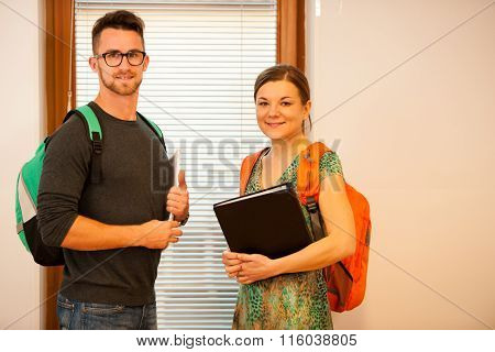 Grownup Couple Representing Lifelong Learning. Couple With School Bag Smiling As A Gesture Of Happin
