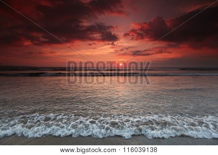 Beautiful sea beach under coudy sunset sky on Bali