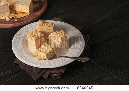 Pieces Of Cake Napoleon Closeup In White Plate
