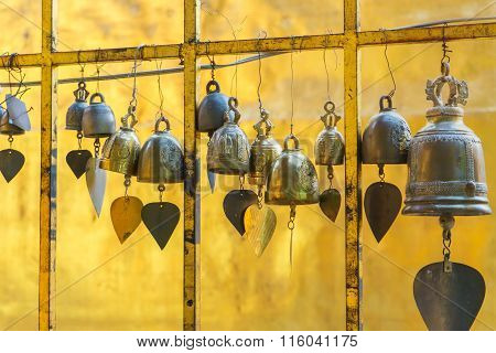 Small Bells Hanging On Palisade In Buddhist Temple