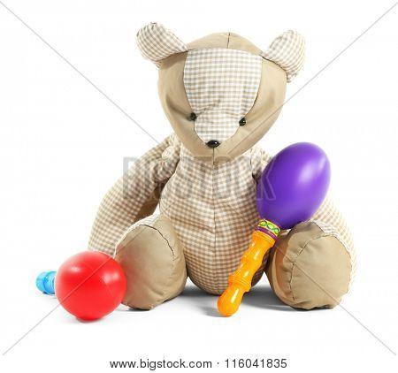 Teddy bear with maracas, isolated on white