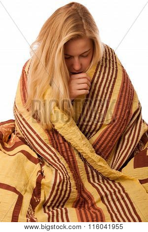 Sick Woman Sitting On Bad Wrapped In A Blanket Feeling Ill, Has Flu And Fever.