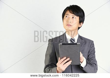 Asian business man standing holding