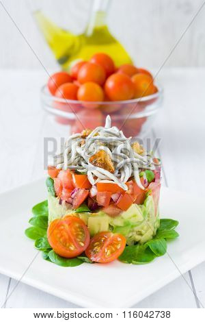 Vegetables and baby eels or elvers tartare
