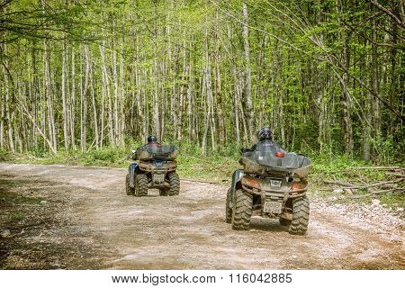 Two Men On The Atv Quad Bikes.