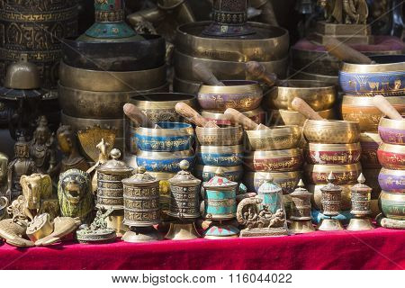 Several Singing Bowls Displayed At A Market In Kathmandu, Nepal