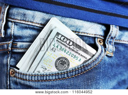Dollars in jeans pocket closeup